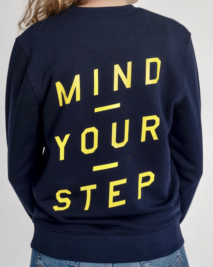 "SPECIAL EDITION!  Full colour logo on the front. ""Mind Your Step"" on the back! Unisex Sweater, Crew Neck, Navy Blue"