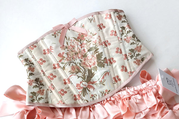 Marie Antoinette inspired lingerie and corset set with pink flowers and ruffled knickers