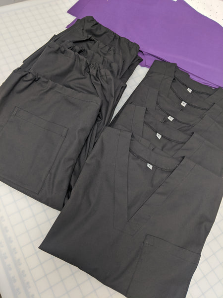 Black and purple scrubs and PPE, sewn and donated to the NHS by Angela Friedman