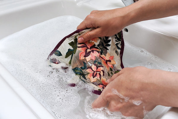Hand washing underwear in soapy water, with tips and tricks for better laundry