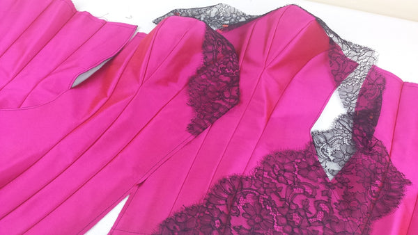 Bespoke corsetry by Angela Friedman in pink silk with black French lace