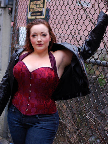 Plus sized custom corset as outerwear with a leather jacket
