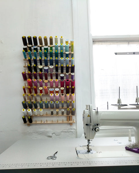 Sewing machine in the corsetmaker studio with colourful thread spools