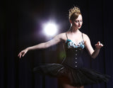 Ballerina wearing a tutu and black underbust corset waist cincher