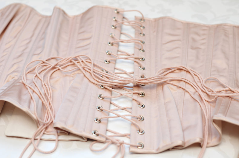 Pink corset lacing flatlay vintage inspired bridal bride Brigitte corset in silk satin, 100% silk pink blush corsetry real corsets, steel boned coutil satin