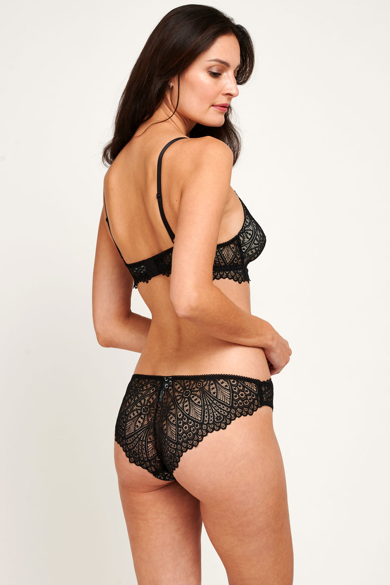 Designer lingerie set in black lace with a sheer bralette and knickers