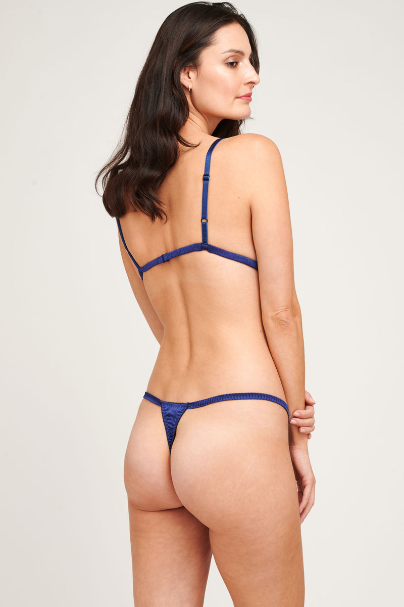 Luxury lingerie set in navy blue silk satin with bralette and thong panties