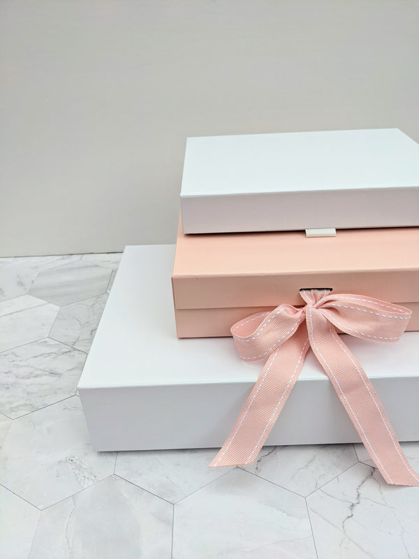 Luxury rigid gift boxes in pink and white for lingerie sets