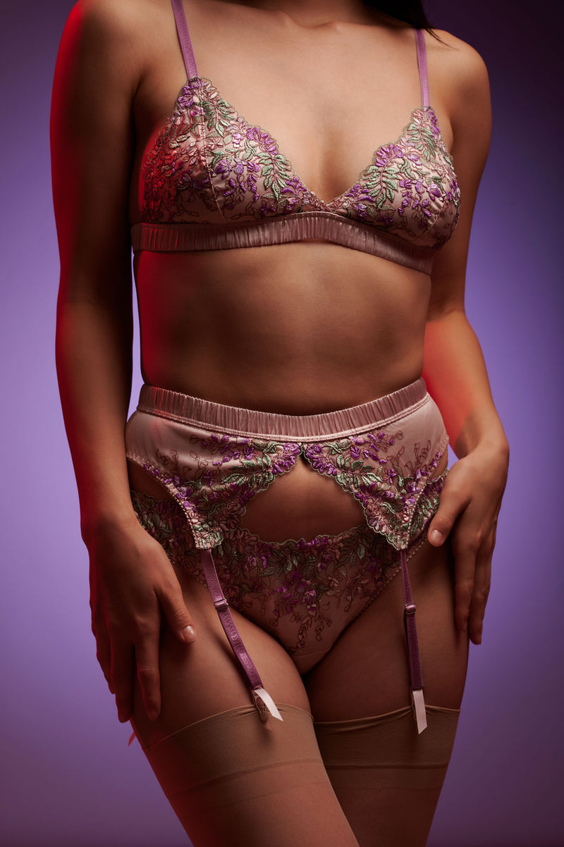 Pink silk suspender belt with violet embroidered garter straps