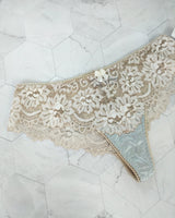 Blue silk and cream lace thong knickers by designer Angela Friedman