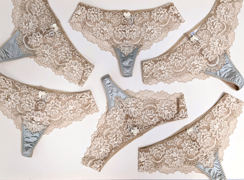 Cream and blue lace underwear and silk panties
