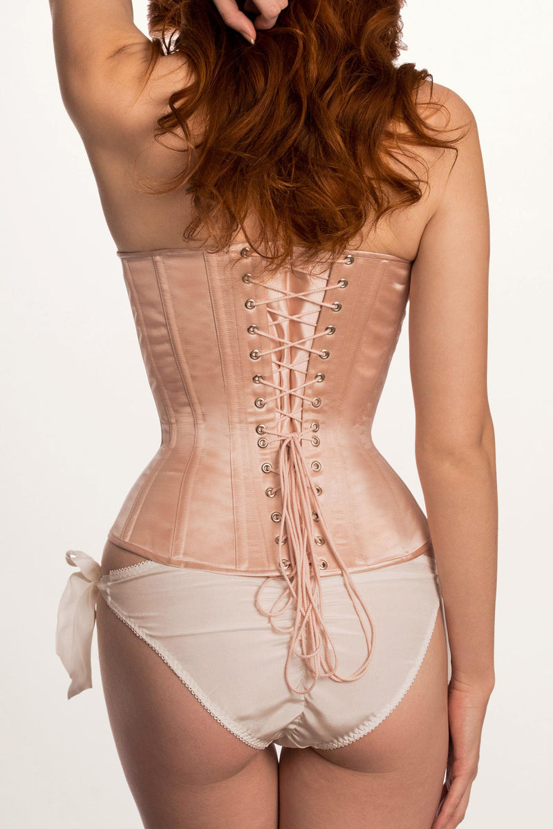 Pink silk satin corset with blush laces and steel boning