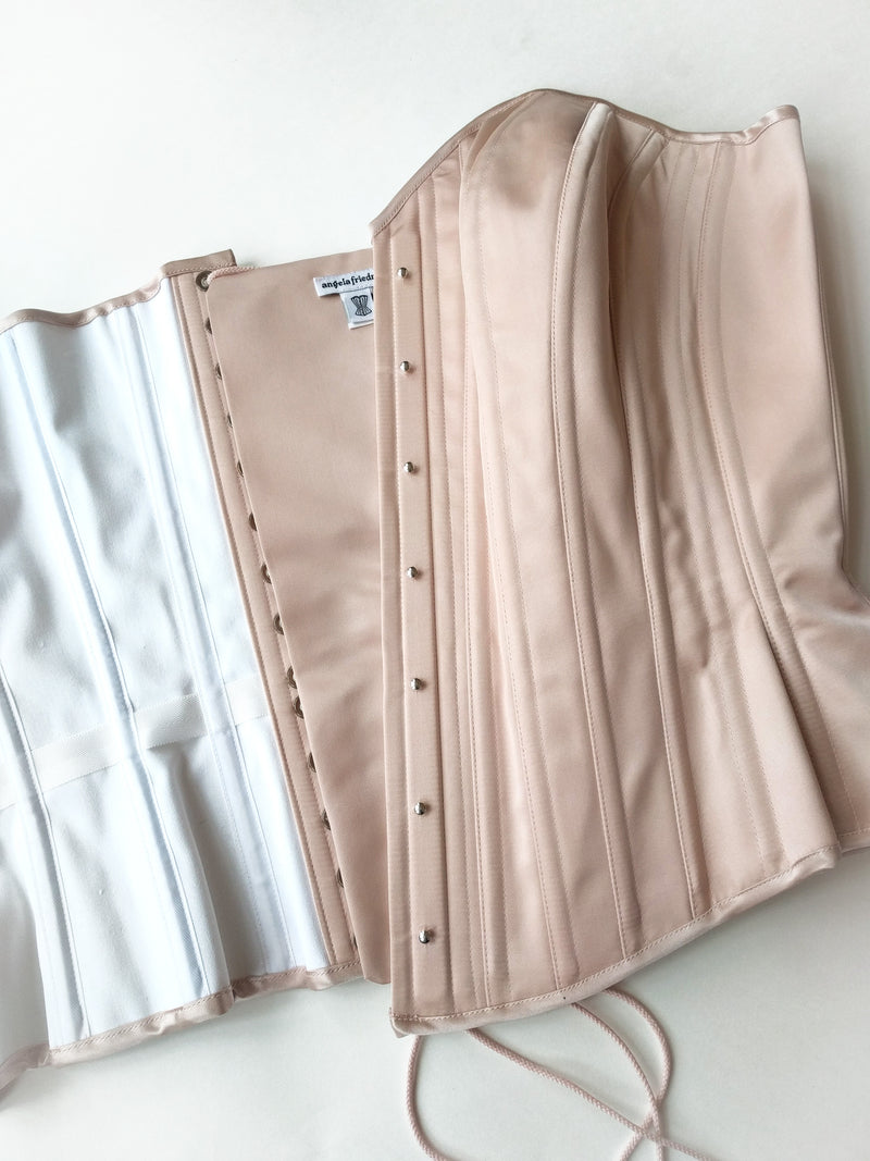 Pink corsets in 100% silk satin by vintage style corset designer Angela Friedman