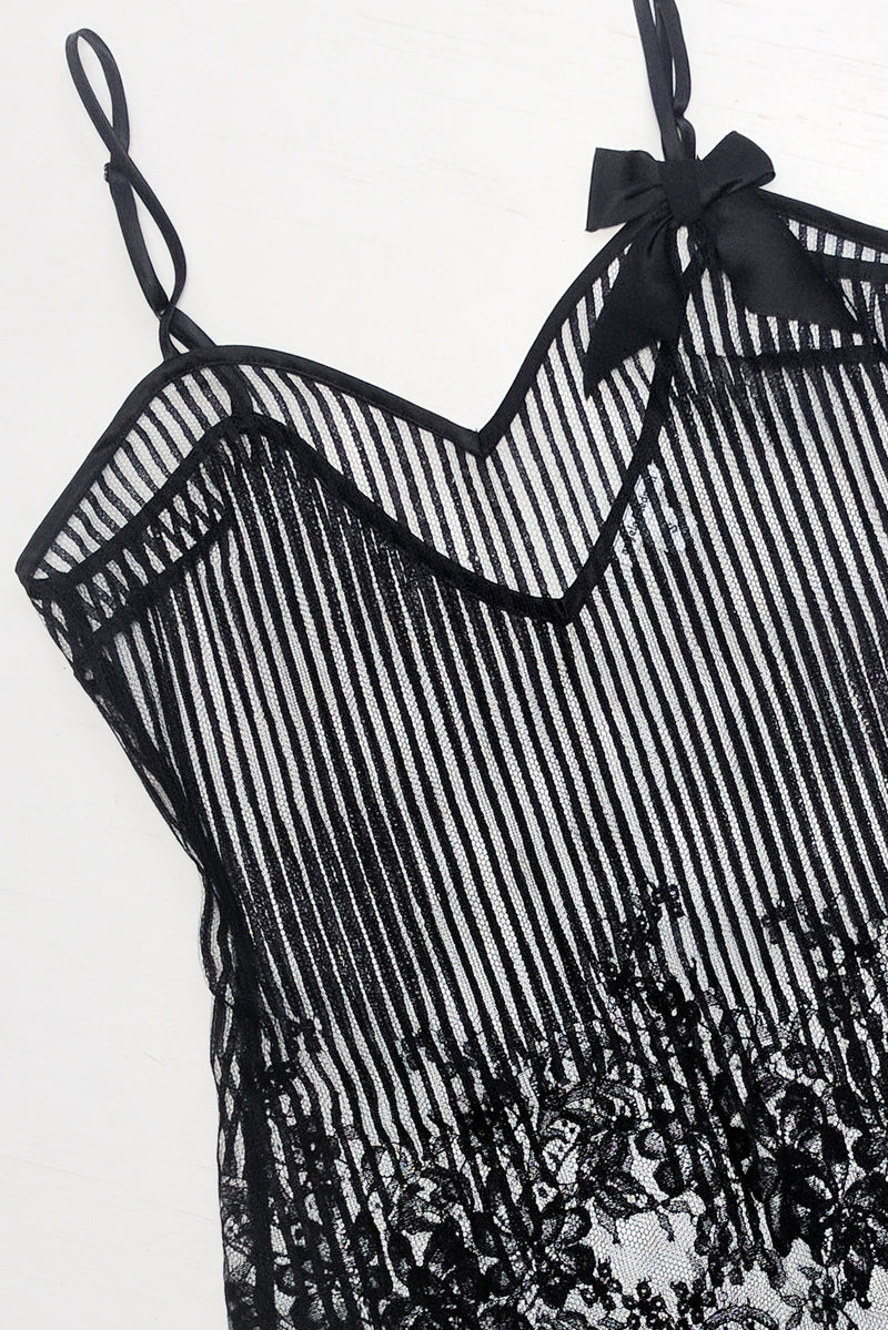 Dentelle slip by Angela Friedman in black French lace, flatlay of black lace slips