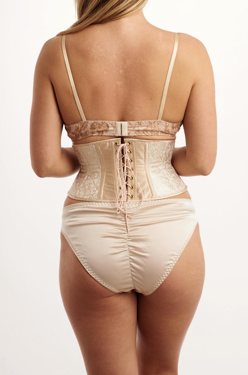Blush pink silk corset with a satin luxury lingerie set