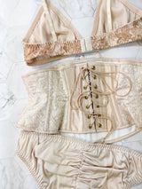Luxury lingerie set with a gold pink waspie corset and bow