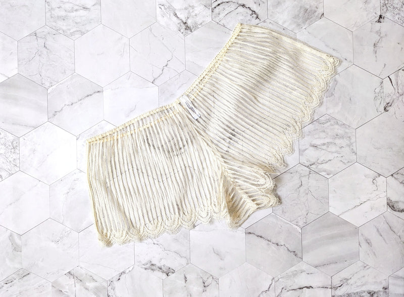 Off white lace tap pants with scalloped eyelash edges