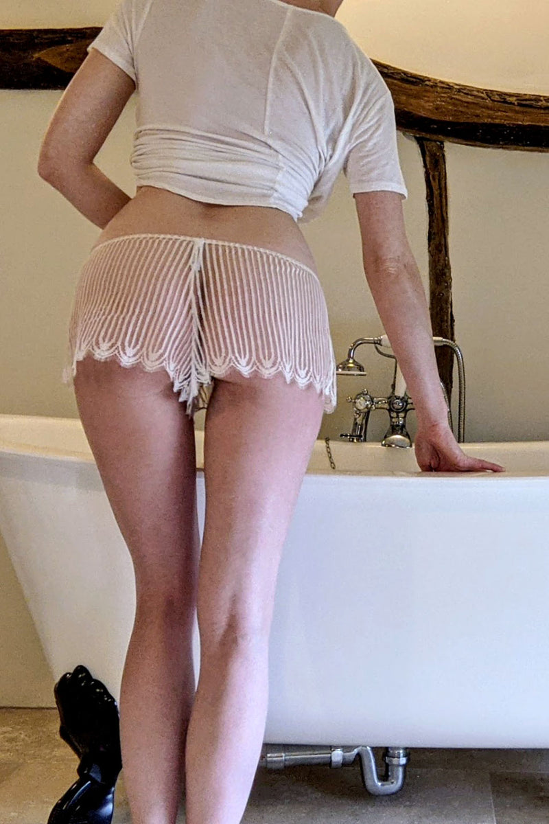 Ivory sheer french knickers with a claw foot bathtub