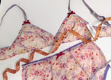 Designer underwear in pink floral mesh with purple elastic trim and tape measure