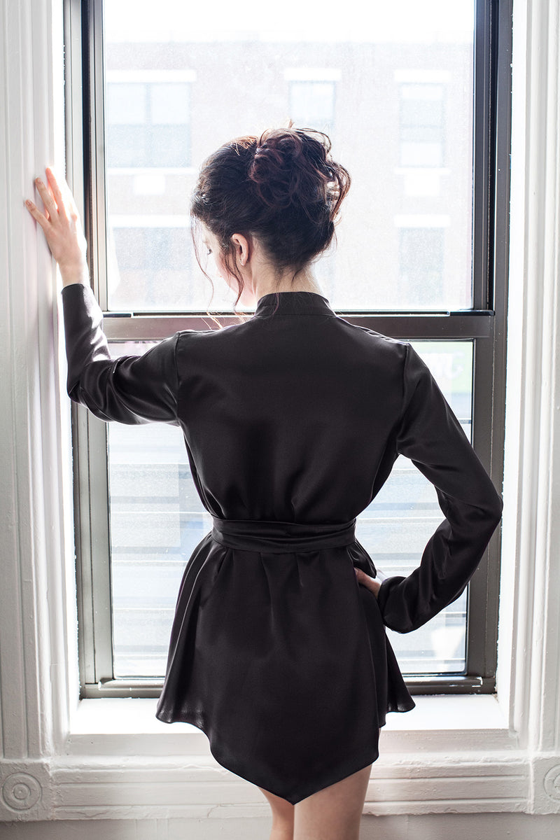 Back of a black satin robe in 100% pure silk