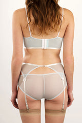 Vintage style lingerie set with a garter belt, mesh knickers, and longline bralette