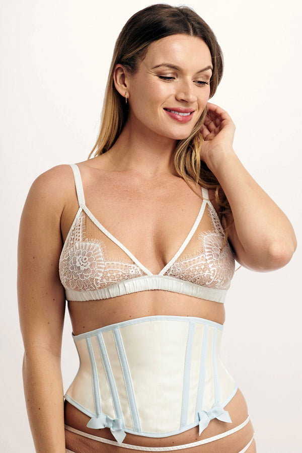 "Handmade bridal corset in ivory silk with ""something blue"" trim and bows"