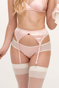 Pink silk lingerie set with vintage style suspender belt and white stockings