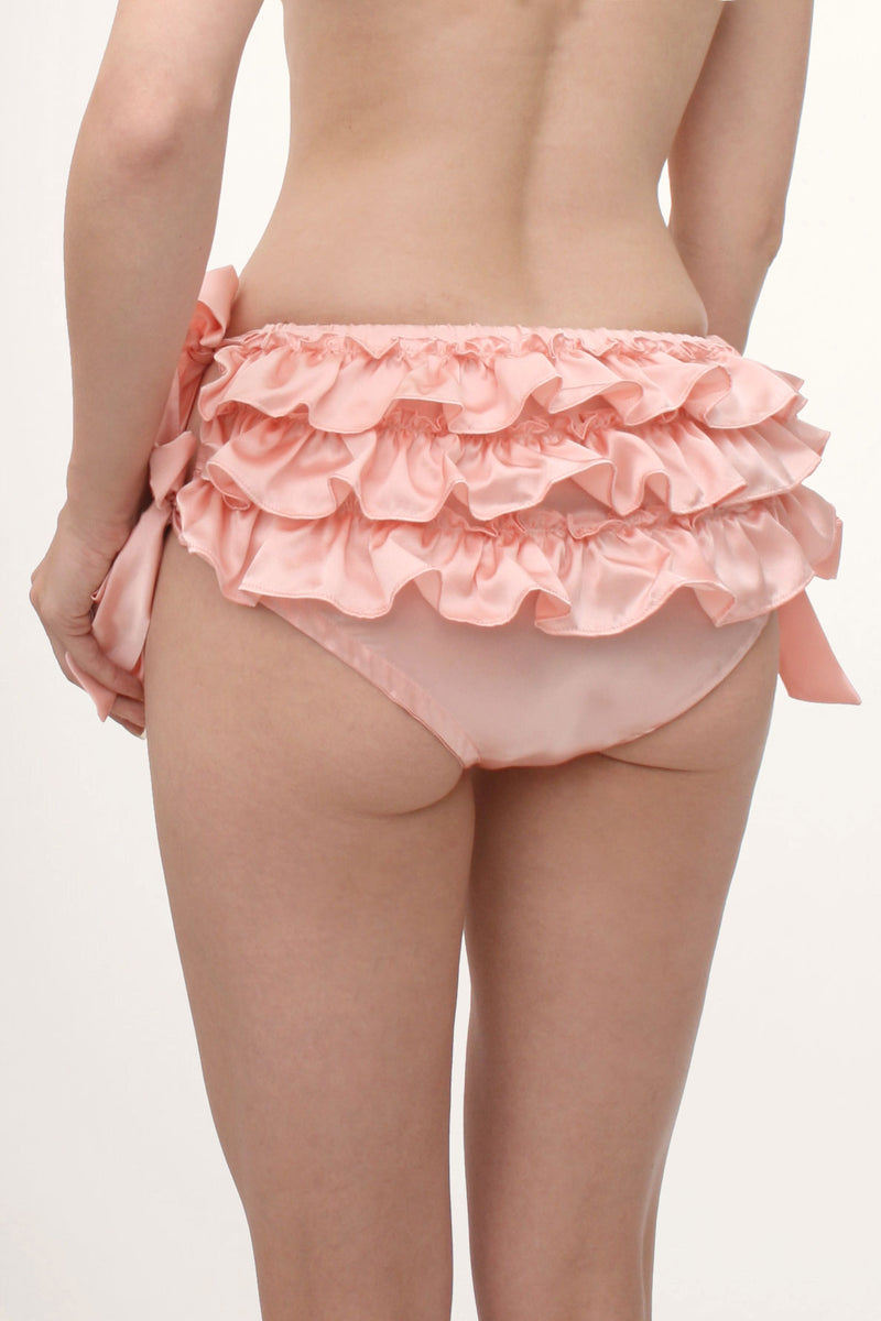 Frilly pink silk underwear with ruffles on the back