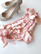 Vintage bridal shoes and pink ruffled bloomers with side ties and bows