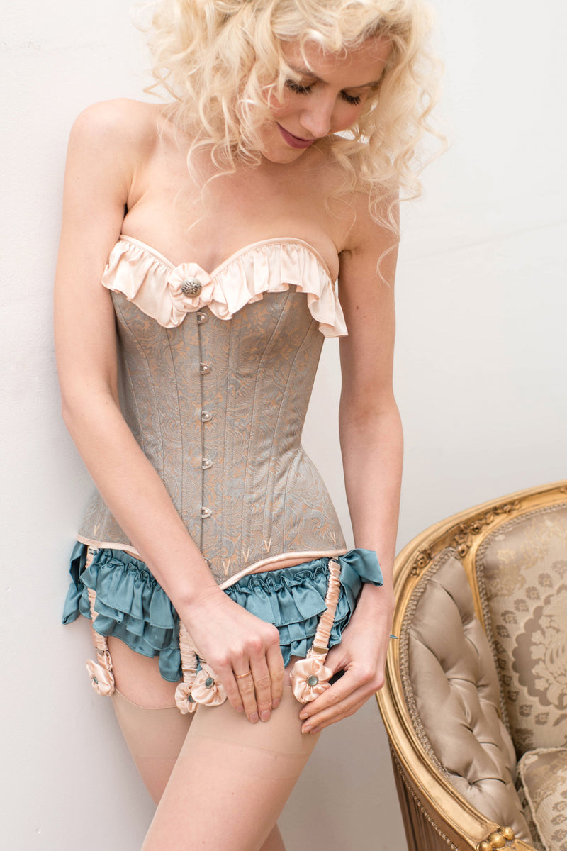 Designer Victorian corset with aqua silk satin ruffled panties and pink garters and stockings