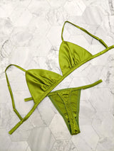 Flat lay of chartreuse green lingerie set in pure silk satin