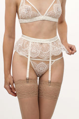 White lace suspender belt and garters for a bride on her wedding night