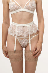 Luxury wedding lingerie set with a white lace suspender belt and thong