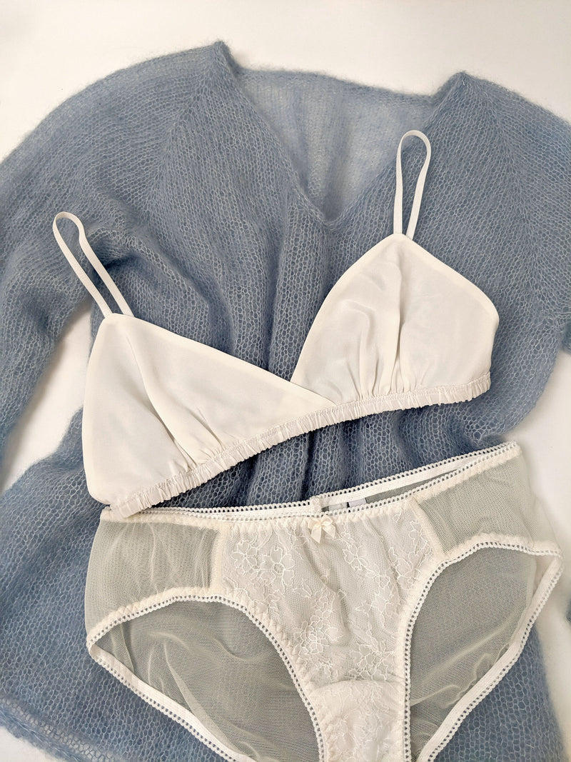 100% silk bralette with white lace underwear and a blue handknit jumper