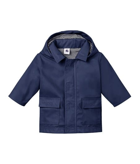 petit bateau-blue rain coat- baby at the bank