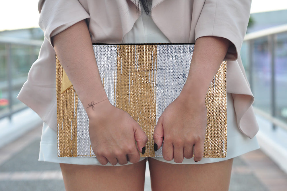 Gold and Silver Stripe Metallic Clutch .