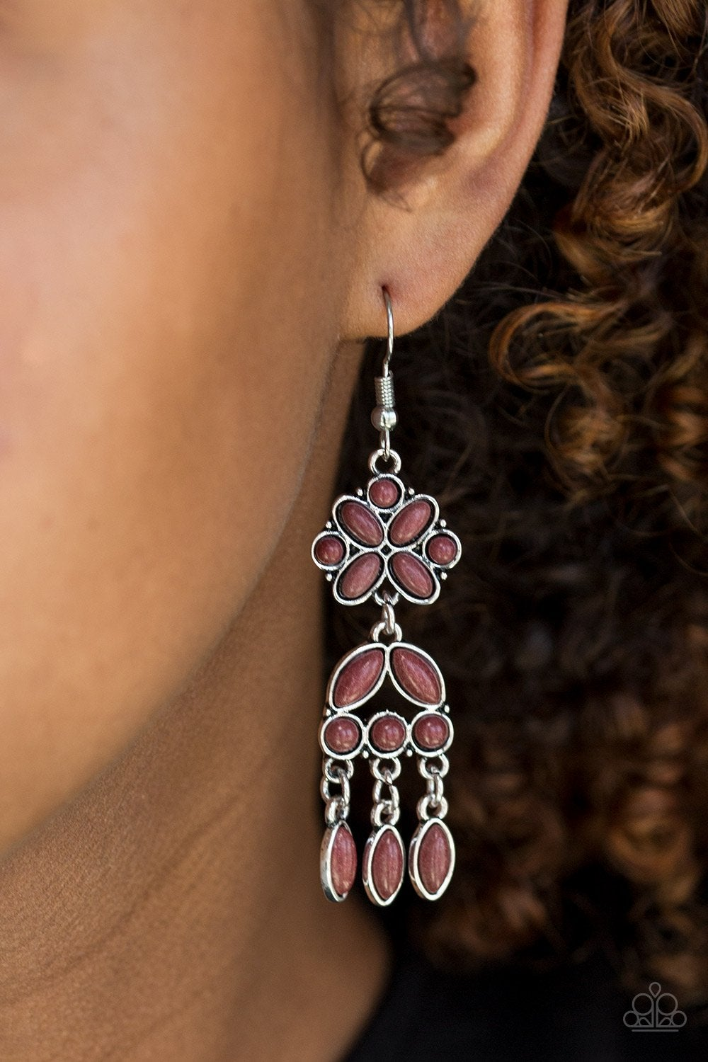 Chiseled into round, oval, and marquise shapes, robust brown stones are pressed into a stacked silver lure for a whimsical western look. Earring attaches to a standard fishhook fitting.