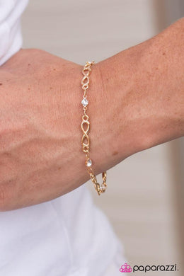 Bracelet: Endless Excellence - gold infinity with white rhinestones | Paparazzi Jewelry