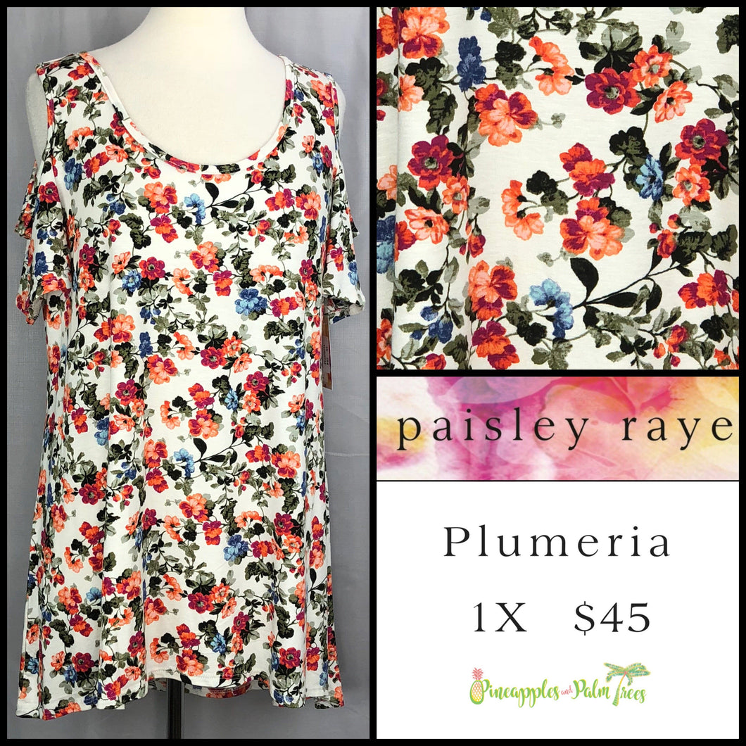 Paisley Raye White Floral 1X Plumeria. Shop this beautiful Paisley Raye Plumeria top and more at pineapplesandpalmtrees.net or locally in the Twelve Bridges Community of Lincoln, California.