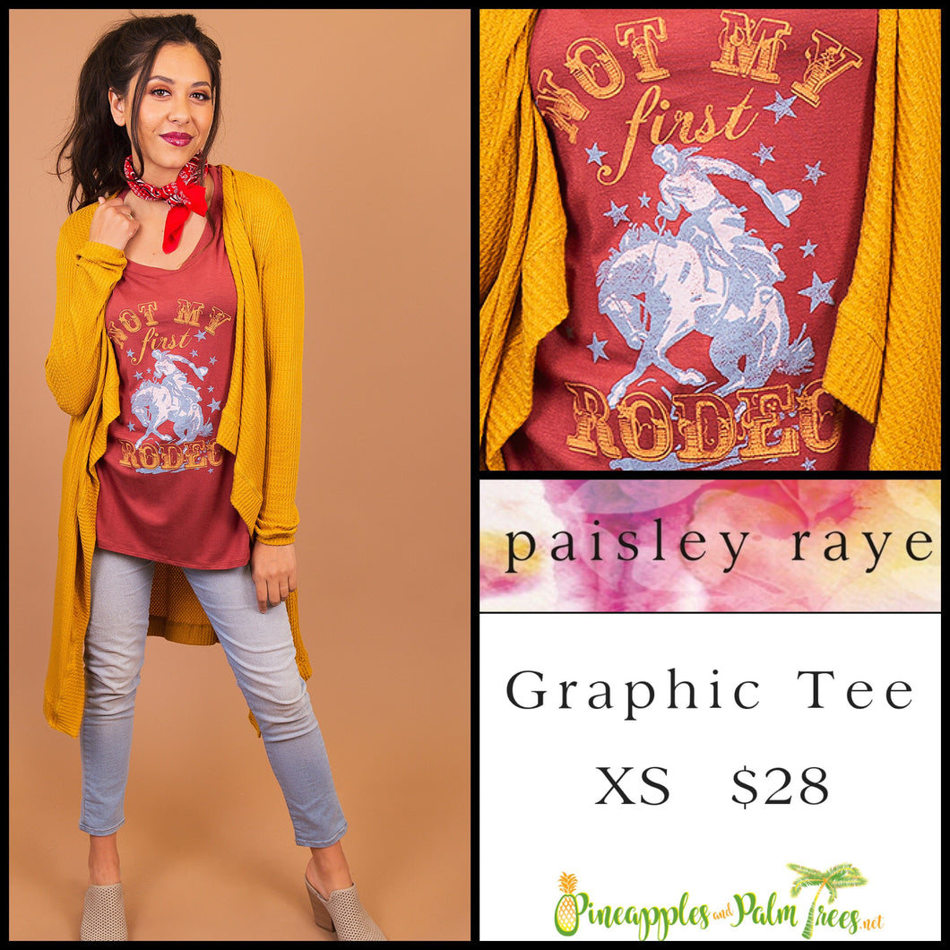 Paisley Raye Graphic T, S Wine T with 'Not My First Rodeo', shop these Paisley Raye Graphic Tee's and more at pineapplesandpalmtrees.net or locally in the Twelve Bridges Community of Lincoln, California.
