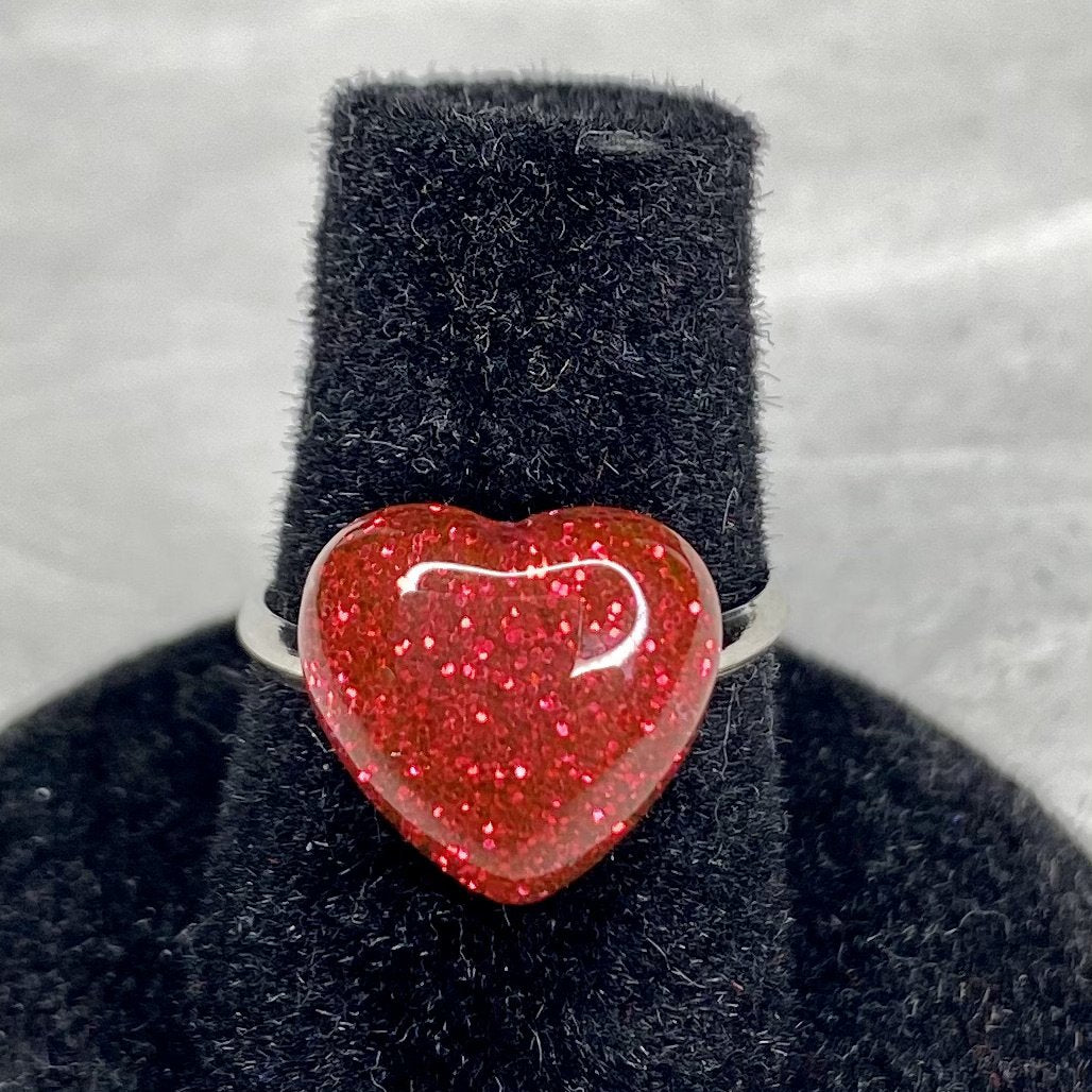 Red glitter heart on an adjustable silver ring.