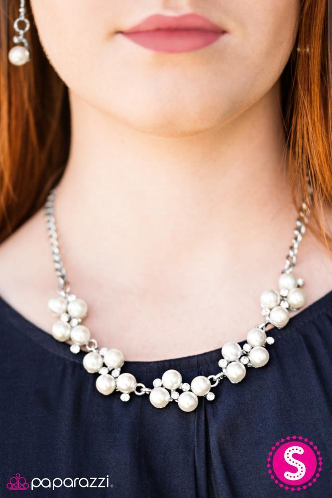Dainty clusters of shimmery white pearls are dusted with sparkling rhinestones, creating a romantic, timeless design. Features an adjustable clasp closure.  Sold as one individual necklace. Includes one pair of matching earrings.