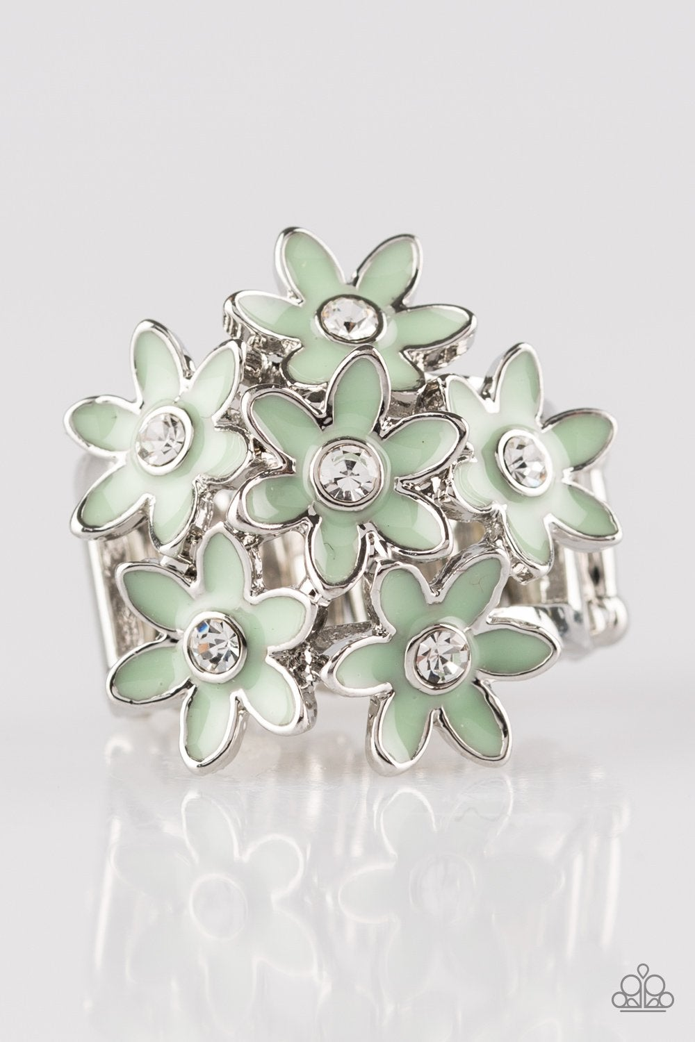 Painted in refreshing green finishes, dainty silver flowers bloom atop the finger. Glassy white rhinestones are sprinkled across the floral bouquet, adding a refined finish to the seasonal palette. Features a stretchy band for a flexible fit.