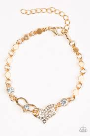 Encrusted in glassy white rhinestones, two gold hearts join at the center of the wrist. Flat gold beads and glittery white rhinestones are added to the chain, enhancing the timeless shimmer. Features an adjustable clasp closure.