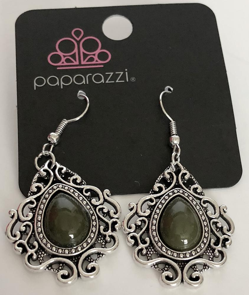 A green teardrop bead is pressed into the center of a frilly silver frame, creating a colorful lure. Earring attaches to a standard fishhook fitting.