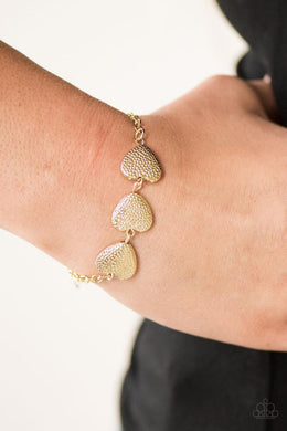 Bracelet: Hard Hearted - gold hearts | Paparazzi Jewelry