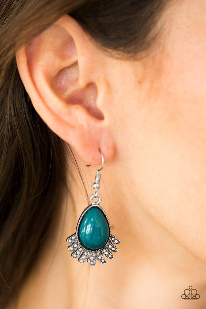 Encrusted in faceted silver studs, antiqued silver frames flare out from the bottom of a refreshing blue bead, creating a colorful lure. Earring attaches to a standard fishhook fitting.