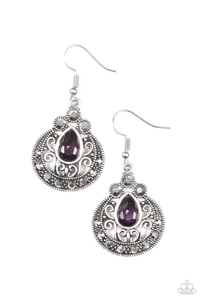 Featuring a regal teardrop cut, a glittery purple rhinestone is pressed into an ornate silver frame radiating with glittery hematite rhinestones for a refined look. Earring attaches to a standard fishhook fitting.