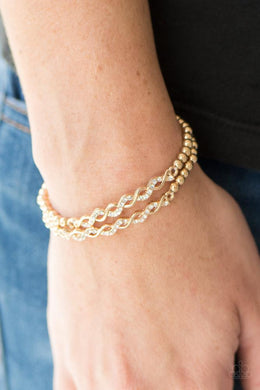 Bracelet: Uptown Utopia - gold with white rhinestones | Paparazzi Jewelry