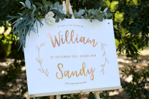 Boho wedding style, welcome sign displayed on easel